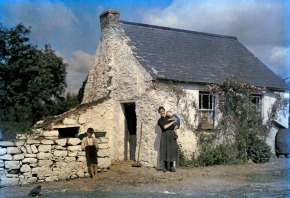 March 1927, Cork, Ireland --- A family stands outside their cottage --- Image by © Clifton R. Adams/National Geographic Creative/Corbis